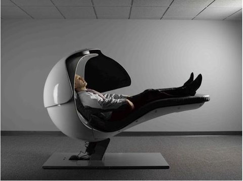 Man reclining in an 'Energy Pod', the Huffington-Post-style napping machine.