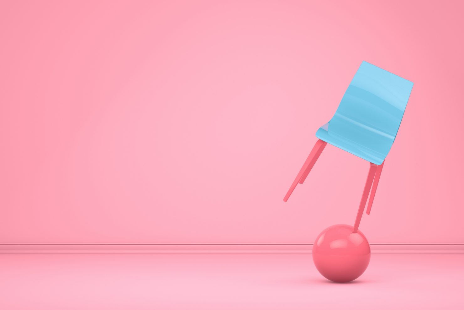 Picture of a blue and pink chair being balanced on top of an exercise ball to represent work-life balance.