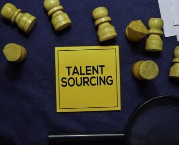 Talent Sourcing text on sticky notes isolated on office desk.